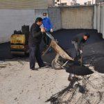 اجرای عملیات لکه گیری بخش های فرسوده آسفالت مدرسه شهید صادق امامی و خیابان ده متری شهید کریمی